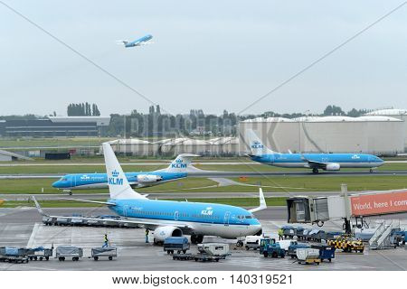 Amsterdam - July 1, 2016: KLM airlines aircrafts moving on runways at Amsterdam airport in the daytime
