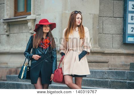 Two pretty girls walking in the city
