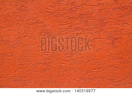 Сoral painted brick wall as background texture