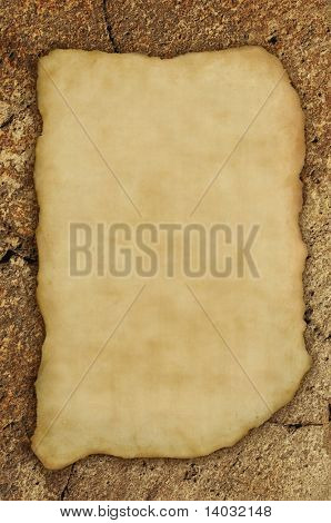 Ancient parchment fragment on rock background