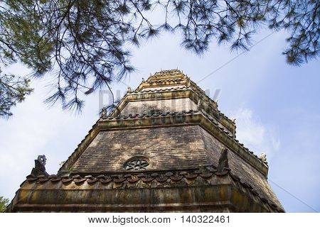 Close up portrait of Thien Mu buddha tower - a very well known sightseeing in Hue ancient capital (recognized World Heritage Site by UNESCO), Vietnam.