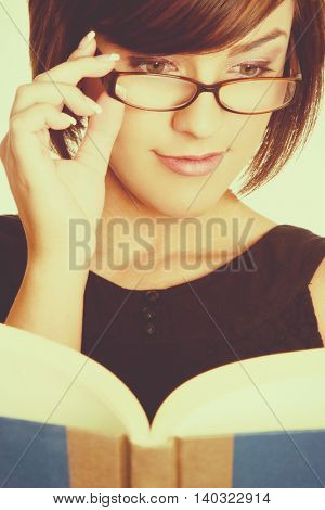 Beautiful young woman reading book