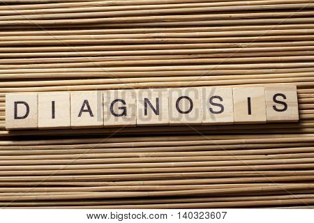 Diagnosis written in wooden cubes on a table.