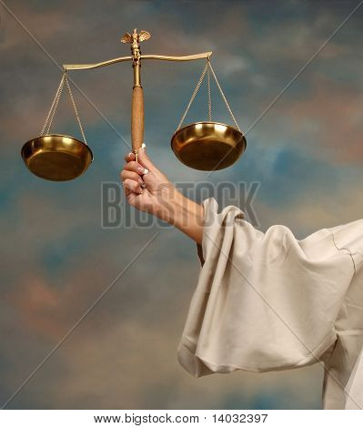 Arm of Lady Justice holding scales