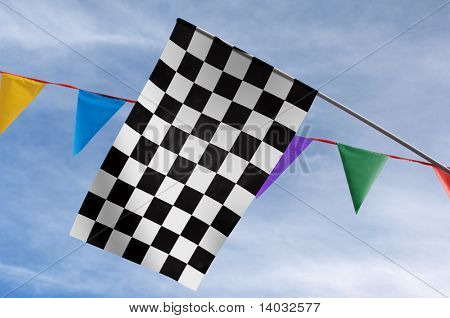 Checkered flag against colorful penants and a blue sky