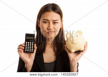 Unhappy Asian Business Woman With Calculator And Piggy Bank.