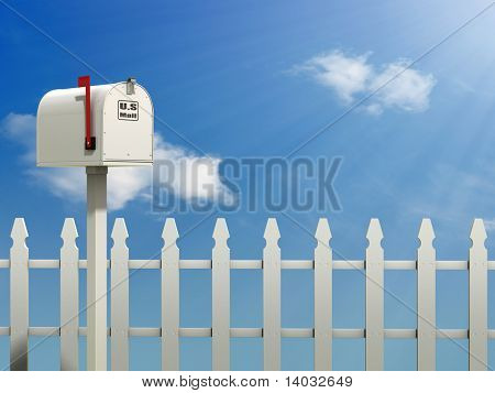 A Mail Box against a Blue Sky and white picket fence background