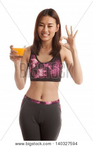 Beautiful Asian Healthy Girl Drinking  Orange Juice Show Ok Sign.