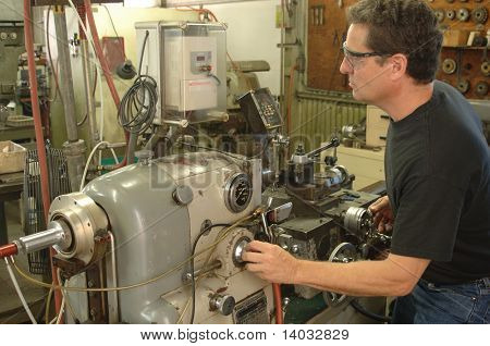 Machinist working a metal lathe