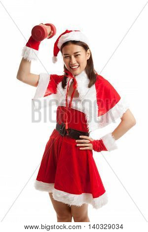 Asian Christmas Girl With Santa Claus Clothes And Red Dumbbell.