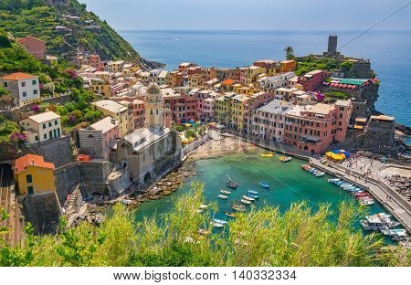 VERNAZZA, ITALY - JULY 5, 2016:  The village of Vernazza, Italy from the costal Cinque Terre trail along the northwestern coast of Italy.
