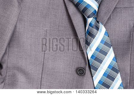 Closeup necktie and grey suit top view