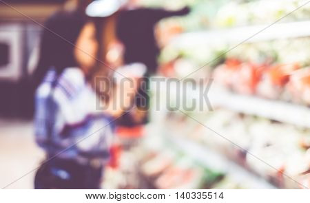 Blur Background Of Woman Customer Select Fresh Product On Shelf In Supermarket