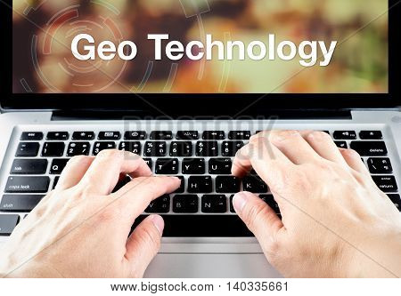 Geo Technology Word On Notebook Screen With Hand Type On Keyboard, Location Technology Concept