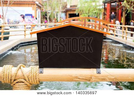 Signage In Japanese Style On Railing Bridge Over Canal