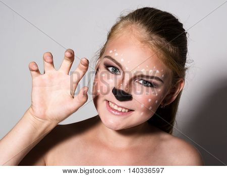 Beautiful girl with funny make-up, expresses different emotions. Funny image of beautiful pretty girl.