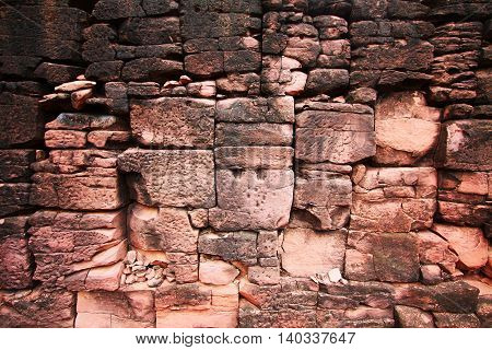 Brown rustic sandstone brick wall from the old structure