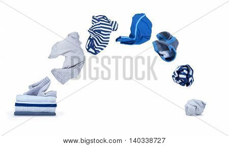 clothes fly out of pile and falls down isolated on white