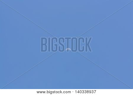 The moon in blue sky, Part of the moon on a background of blue sky