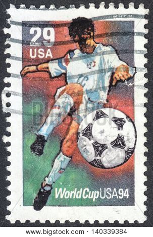 MOSCOW RUSSIA - CIRCA APRIL 2016: a post stamp printed in the USA shows a football player the series