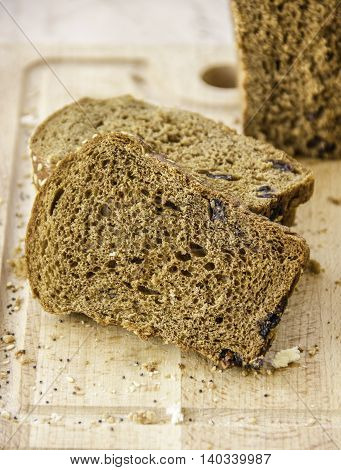 fresh baked sliced rye bread with prunes crunchy