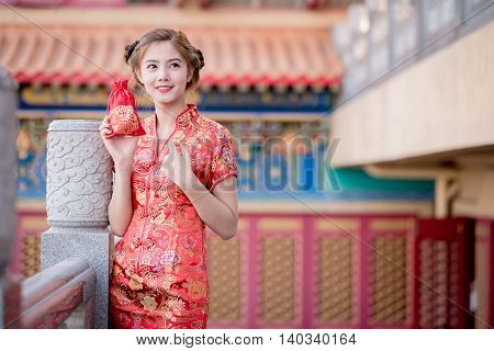 The Asian Chinese Woman In Traditional Chinese Hold Gift Bag