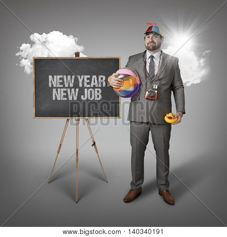 New year new job text with holiday gear businessman and blackboard with text