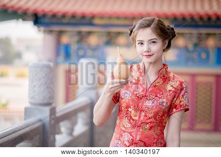 The Asian Chinese Woman In Traditional Chinese Hold Calabash