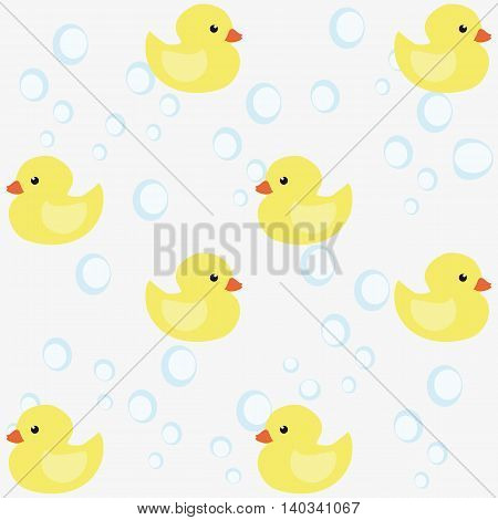 Seamless pattern of small yellow ducks and bubbles on a light background. Vector illustration.