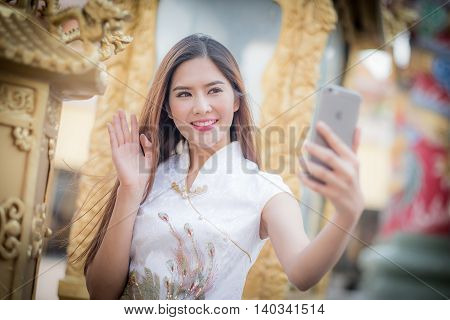 Asian Chinese Woman In Traditional Chinese And Hold Telephone