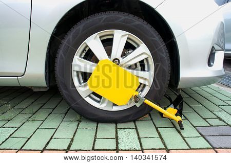 Car was locked with clamped vehicle wheel lock. Parking on forbidden place.