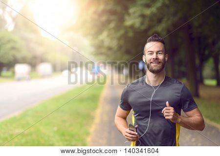 Man Jogging Along A Sidewalk On A Busy Road