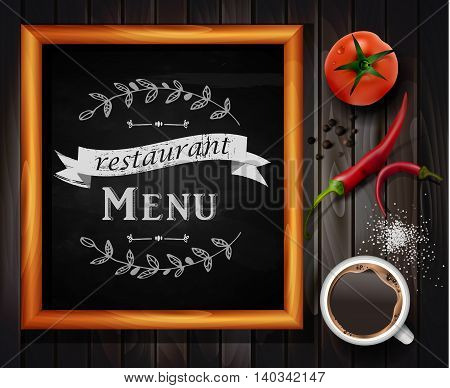 Menu on Chalkboard background with hand drawn ornament for restaurant in wooden frame on wooden background with two tomatos coffee chili pepper and salt or sugar.