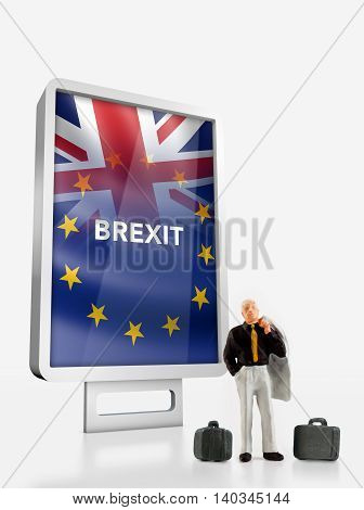 Miniature people - people in front a billboard with United Kingdom and European union flags combined for the 2016 referendum