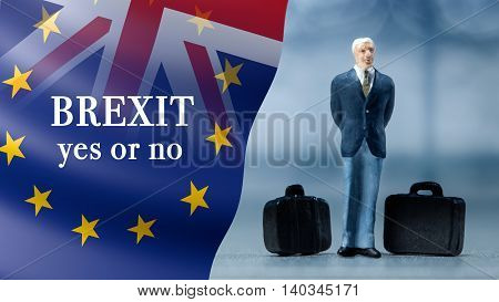 Miniature people - a businessman posing with United Kingdom and European union flags combined for the 2016 referendum