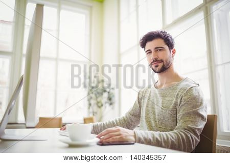 Portrait of confident businessman working in creative office