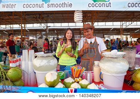 PATTAYA, THAILAND - FEBRUARY 21, 2016: outdoor portrait of chinese woman and a seller at street market in Pattaya. There are few street markets in Pattaya that are popular with tourists and locals