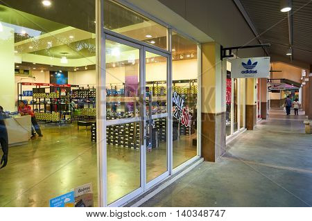 PATTAYA, THAILAND - FEBRUARY 21, 2016: Adidas outlet in Pattaya. Adidas AG is a German multinational corporation that designs and manufactures sports shoes, clothing and accessories.