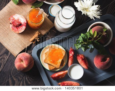 Summer Breakfast With Peaches, Jam And Toasts