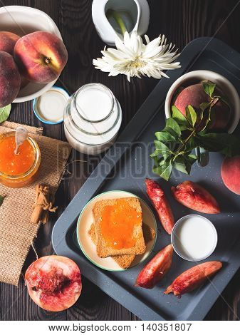 Summer Breakfast With Fruit And Toasts On Dark Background