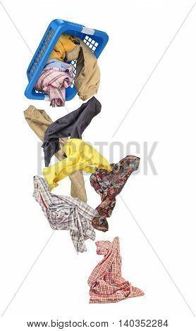 Clothes falling out of the basket isolated on white background
