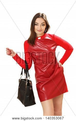 young woman in a red dress with a handbag. a vertical portrait on a white background