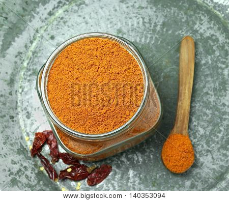 Homemade chili powder, which is finely ground, on a vintage metal tray, a traditional and commonly used Indian cooking ingredient.