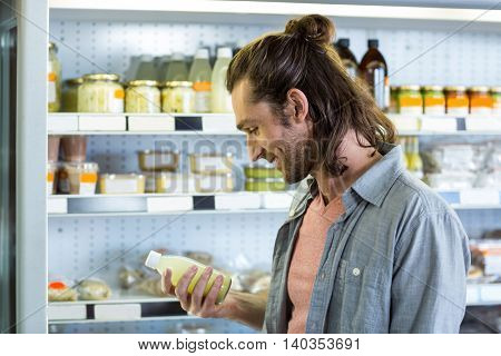 Man shopping for groceries in supermarket