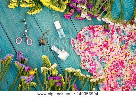 Dress, Colorful Flowers, Cosmetics Makeup, Bijou And Essentials On Blue Wooden Background