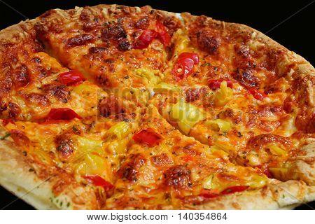 Big fresh pizza on a black background