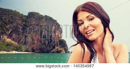 summer vacation, tourism, travel, holidays and people concept -face of happy young woman over sea and island rock at tropical beach on bali background
