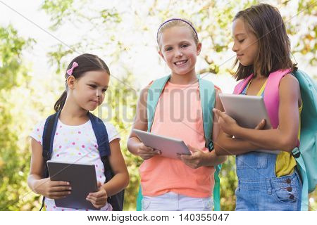 Portrait of school kids using digital tablet at school campus