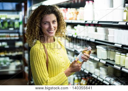 Man interacting with woman while holding egg carton in supermarket