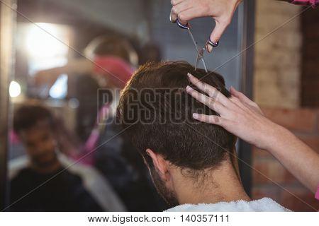 Man getting his hair trimmed at the hair salon